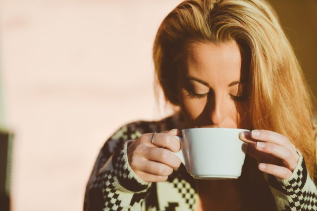 coffee fat woman drinking a cup of coffee